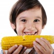 Little boy eating corn — Stock Photo