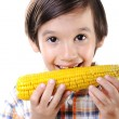 Little boy eating corn — Stock Photo #13335585