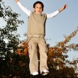 Kid jumping very high — Stock Photo #13335684