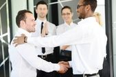 Business handshake after signing new contract — Stok fotoğraf