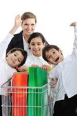 Mother with children in shopping — Stock Photo