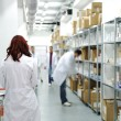 Workers at workplace, drug storage — Stock Photo #21336353