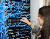 Female administrator at server room — Stock Photo