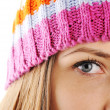 Stock Photo: Closeup eye of Happy Winter Beautiful Girl