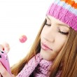 Winter Beautiful Girl reading sms message on cell phone — Stock Photo