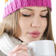 Happy Winter Beautiful Girl drinking hot tea — Stockfoto #21341761
