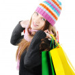 Beautiful winter girl with shopping bags — Stock Photo #21342225