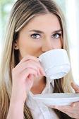 Woman drinking coffee closeup — Stock Photo
