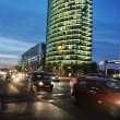 Cars motion on street in the downtown at night (blurred scene) — Stockfoto
