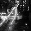Modern Urban City at Night with Freeway Traffic, black and white — Stock Photo
