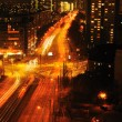 Modern Urban City at Night with Freeway Traffic — Stock Photo