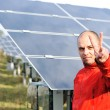 Young male worker with solar panels in background — Stock Photo