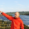 Male worker at solar panel field — Stock Photo