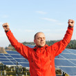 Success, engineer in solar panel fields with arms up — Stockfoto
