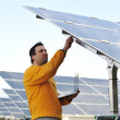 Young expert working at solar panels — Stock Photo