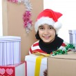 Happy girl with christmas present boxes - Stock Photo