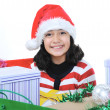 Happy girl with christmas present boxes — Stock Photo