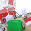 Shopping cart with boxes and bags, happy holidays — Stock Photo #21358205