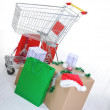 Shopping cart with boxes and bags, happy holidays — Stock Photo #21358303