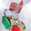 Shopping cart with boxes and bags, happy holidays — Stock Photo #21358307