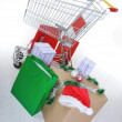 Shopping cart with boxes and bags, happy holidays — Stock Photo
