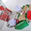 Shopping cart with boxes and bags, happy holidays — Stock Photo #21358385