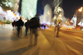Crowd walking in the city at night (blurred scene) — Stock Photo