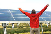 Success, engineer in solar panel fields opening arms up — Stock Photo