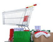 Winkelwagen met vakken en tassen, gelukkige vakantie — Stockfoto