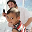 Haircut, father and son — Stock Photo