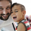 Father and son laughing — Stock Photo