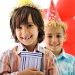 Birthday party, happy children celebrating, balloons and presents around — Stock Photo #21364393
