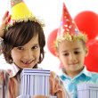 Birthday party, happy children celebrating, balloons and presents around — Stock Photo #21364485