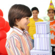 Stock Photo: Birthday party, happy children celebrating, balloons and presents around