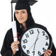 Graduate girl student in gown with diploma and clock — Stock Photo #21368471