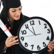 Graduate girl student in gown with diploma and clock - Foto de Stock
