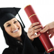 Graduate girl student in gown receiving diploma — Stock Photo #21368725