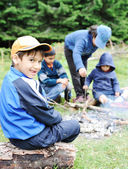 Barbecue in nature, group of children preparing sausages on fire — Stock Photo