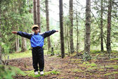 Kid in forest — Stock Photo