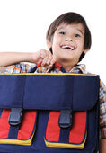 Backpack for school, in hands of kid — Stock Photo