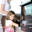 Young mother and little girl daughter in kitchen — Stockfoto