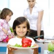 Happy family in the kitchen, mother and children cooking together — Stock Photo