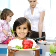 Happy family in the kitchen, mother and children cooking together — Stockfoto