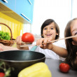 Children alone in the kitchen — Stock Photo