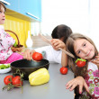 Children alone in the kitchen — Stock Photo