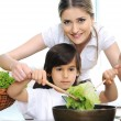 Royalty-Free Stock Photo: Beautiful mother and little son in kitchen together