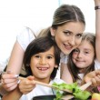 Stock Photo: Beautiful mother with little son and daugther in kitchen together