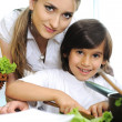 Beautiful mother and little son in kitchen together - Stock Photo