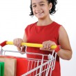 Royalty-Free Stock Photo: Little girl shopper in red dress with shopping cart