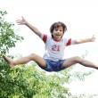 Jumping kid in the air - Stock Photo